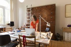 lance writing and consulting resources young female designer working in home office