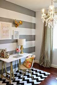 i love everything about this room the graywhitegold color scheme the floral accents the coordination the chandelier the curtainaccent wall all avenue greene grey ladder storage office wall