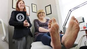 Woman with world's biggest female feet gets her <b>custom</b>-<b>made</b> size ...
