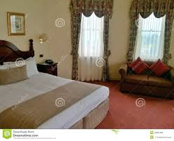living room with bed: hotel room with bed and sofa
