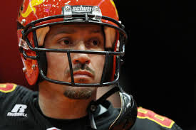 Quarter back Aaron Garcia #8 of the New York Dragons looks up prior to the start of the game against the Grand ... - Grand%2BRapids%2BRampage%2Bv%2BNew%2BYork%2BDragons%2BauXVfEgwXbbl