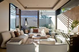tropical living rooms: interior aboobaker by nico van der meulen tropical living room modern tropical home house window glass fur rug white tropical home for better loos