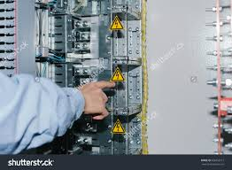 electrician near lowvoltage cabinet uninterrupted power stock electrician near the low voltage cabinet uninterrupted power supply electricity