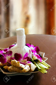 day orchid decor: spa massage decoration herbal bag orchids decor stock photo