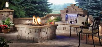 gallery outdoor living wall featuring: elegant design outdoor living space ideas featuring square shape stone firetable and metal chairs with brown seats