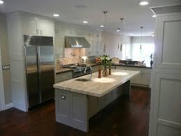 Small Picture Dark wood floorsgrey islandwhite cabinetslight counters and