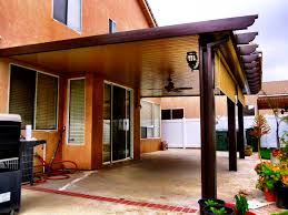 awesome alumawood patio cover with brown poles and cream ceiling plus ceiling fan and outdoor lantern brown covers outdoor patio