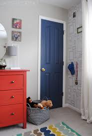 boys bedroom makeover boy bedroom makeover gray walls picture frame wallpaper pops of orange