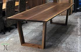 wood slab dining table beautiful: walnut live edge dining table with our solid hardwood trapezoids in our chicago area live edge