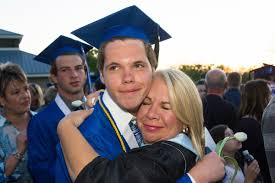 library issue divides sartell in the newsleaders matthew jurek gets a hug from his mother stacey jurek after the ceremony