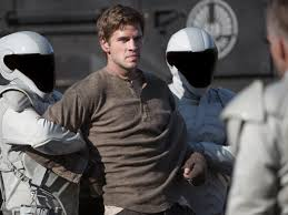 catching fire the hunger games now real heat wcai the third point of the movie s love triangle katniss hunting partner gale hawthorne liam hemsworth remains stranded in district 12 out as much to
