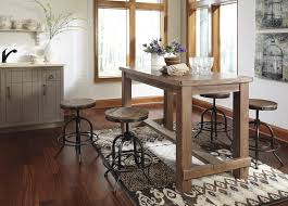 dining room pub style sets: ashley pinnadel  piece weathered counter table and swivel stools set main image