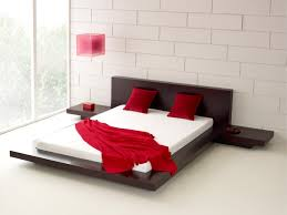 simple elegant modern bedroom design with wooden furniture sets and red pillow also slate wall background bedroom simple modern bedroom design