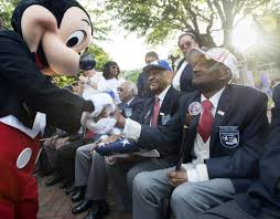 disneyland honors tuskegee airmen during flag ceremony tuskegee airmen