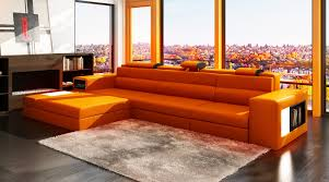 extraordinary orange leather sectional sofa ideas with l shaped and adjustable headrest also having side storage astounding red leather couch furniture