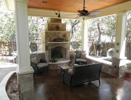 covered patio freedom properties: austin covered porch and fireplace by archadeck of austin