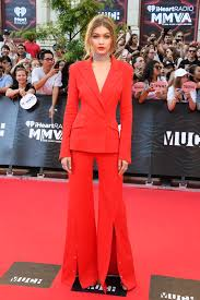 hillary clinton s dnc look and the return of the power pantsuit in red hot gigi hadid in a mugler suit at the 2016 much music video awards in toronto on 19 photo george pimentel wireimage