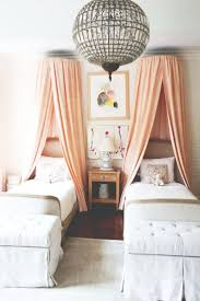 canopy bed curtains girls room childrens bedroom with matching canopy beds and a large chandelier