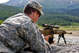 u s department of defense photo essay army spc aaron bowers seats a magazine into his m110 semi automatic sniper system