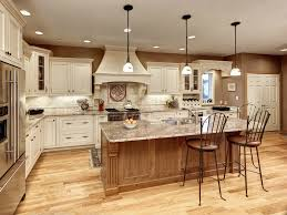 three decorative pendant lights add interest to this elegant kitchen the white globes suspended from add task lighting