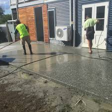working creating patio: we finished using pressure washers and working with brooms to create an even exposed finish