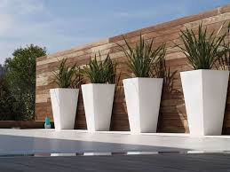 modern patio set outdoor decor inspiration wooden: this would also look good with ground cover grown at the base so that the vines middot white outdoor potsmodern