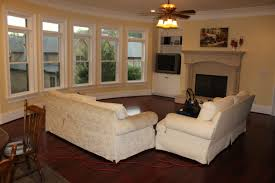 how to organize a living room arranging living room furniture with a corner fireplace guihebaina