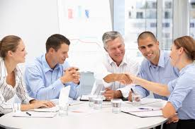 older workers being sought after more by companies aarp business people in meeting