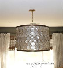 how to make a diy designer capiz drum shade chandelier a la oly studio serena capiz shell lighting fixtures