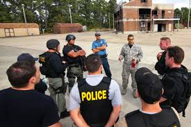 u s department of defense photo essay air force master sgt jose almeida center right instructs airmen and law enforcement