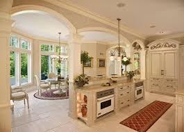 kitchen solution traditional closet: mediterranean kitchen with pendant light kitchen island columns raised panel chandelier