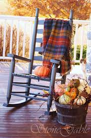 plaid blankets are perfect additions to porch seating furniture when evenings become colder and colder autumn furniture