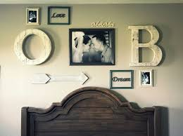 bedroom ideas couples: rustic theme photo wall picture wall his and hers bedroom decor
