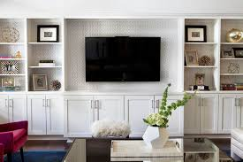 gray trellis wallpaper on back of built ins built living room