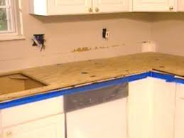 diy tile kitchen countertops: plywood attached to top of cabinets