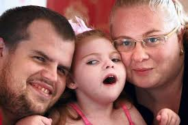 ... suffers from cerebral palsy, epilepsy and blindness but still loves to smile. Now parents Graham Maton and Claire Lowe have launched a campaign for her - C_71_article_1457669_image_list_image_list_item_0_image