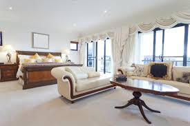 big master bedrooms couch bedroom fireplace: a light and bright master bedroom with a large sofa and chaise lounge in cream with