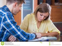 wife homework husband and wife sad faces discussing finances dreamstime com