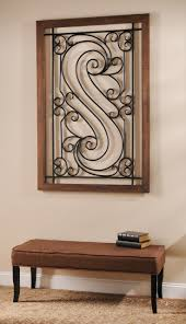 home decor plate x: plaque x crafted of metal and wood composite distressed oak finish features an organic scrolled design extravagant metal centerpiece in dark bronze comes