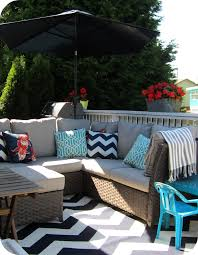 white striped patio umbrella: im looking forward to lots of summer days and evenings on our deck its already had a lot of use and the season is only just starting