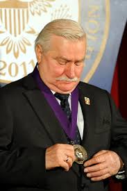 u s department of defense photo essay former polish president lech walesa looks at the 2011 ronald reagan centennial dom award he received
