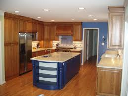 design island cabinets combined white top on the light brown wooden cabinet combined with blue kitchen