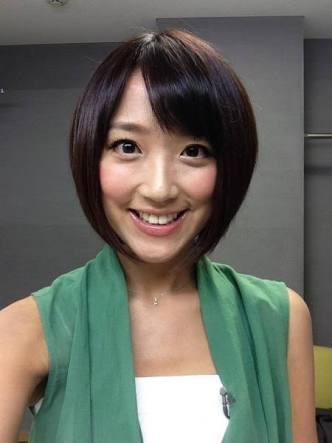 緑の服の竹内アナ