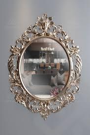 Настенное <b>зеркало</b> в роскошной резной оправе. Отделка ...