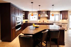 country squire kitchen traditional kitchen idea in toronto with stainless steel appliances and a farmhouse sink awesome farmhouse lighting fixtures furniture