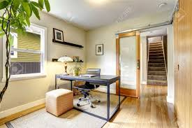 bright office room interior with tree simple black wooden desk with whirlpool chair stock photo bright office room interior
