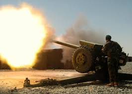 u s department of defense photo essay an artilleryman from the afghan national army s 205th corps fires a round from a d