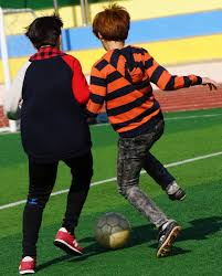 korean children playing soccer photo essay two korean boys compete for control over the soccer ball