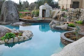modern luxury backyard design with stone that has minimalist nice pool design that decorated with some