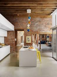 f marvelous kitchen design with brown brick walls decor and colorful balls hanging lamps over white architecture awesome kitchen design idea red